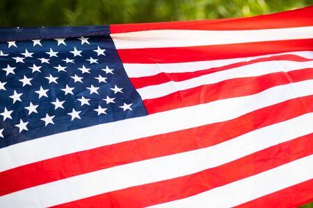 Photo pour woman holding US flag independence day  - image libre de droit