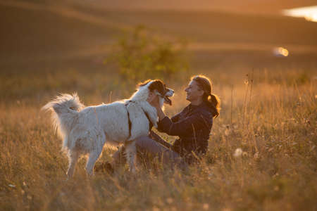 Photo for happy woman with white dog in autumn landscape - Royalty Free Image