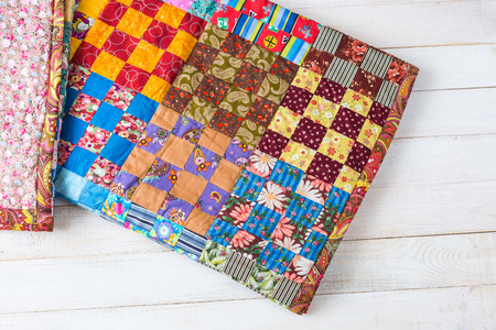 handmade, vintage, interior concept. nice cute little handmade blanket made from different colorful pieces using sewing technique patchwork wildly used in asia