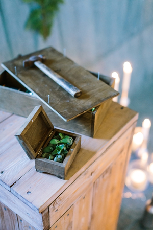 arts and crafts, creating, planting concept. work place of the master with few wooden box, big and small, hammer and lots of blured lights on the background