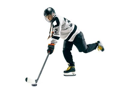 Photo pour Young female hockey player with the stick isolated on white background. Sportswoman in action wearing equipment attacking for the goal or score. Concept of sport, healthy lifestyle, motion, movement. - image libre de droit