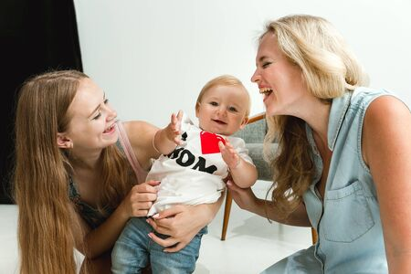 Photo for Young family spending time together and smiling. Mom with young daughter and little son playing and laughting. Family lifestyle. Mothers, fathers day, togetherness, parenthood, kids rights concept. - Royalty Free Image
