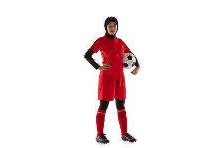 Photo for Arabian female soccer or football player isolated on white studio background. Young woman holding the ball, training, practicing in motion and action. Concept of sport, hobby, healthy lifestyle. - Royalty Free Image