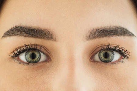 Photo for Close up of face, eyes of beautiful caucasian young woman, clear look. Human emotions, facial expression, cosmetology, body and skin care concept. Hopeful, dreamful look, sight. Psychology, fashion. - Royalty Free Image
