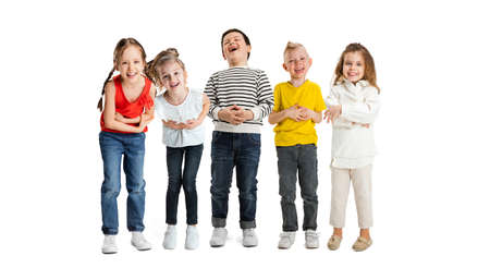Foto de Art collage made of portraits of little and happy kids isolated on white studio background. Human emotions, facial expression concept - Imagen libre de derechos