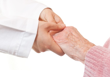 Doctor Holding Senior's Hands