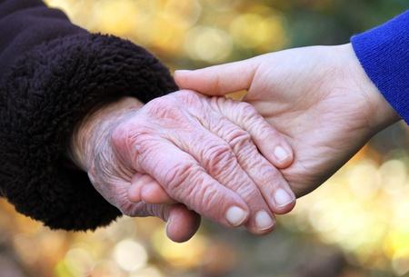 Holding seniors hand