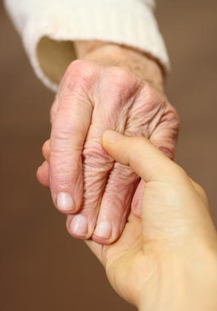 Photo pour Senior and young women holding hands - image libre de droit