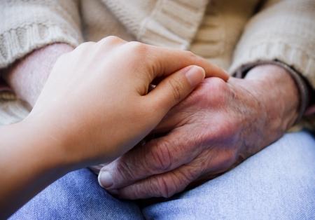 Photo pour Young put her hand on senior lady s hands - image libre de droit