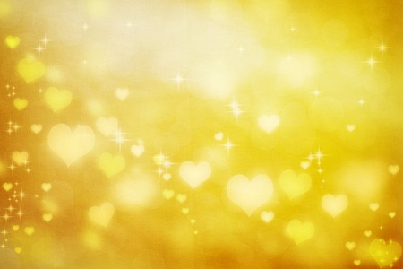 Golden shiny hearts on fabric texture background