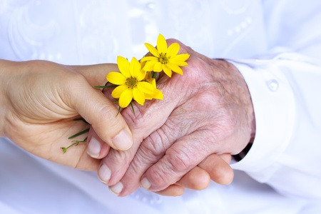Seninor Lady and Young Woman Holding Hands - Giving Flowers  Friendship, Care, Service