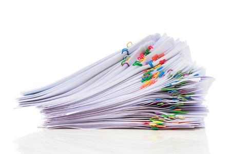 Photo pour Stack of documents with colorful clips  - image libre de droit