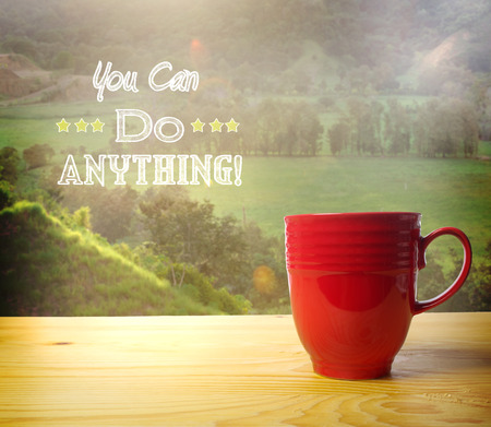 You Can Do Anything text on rural landscape background with coffee cup