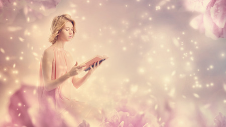 Young woman reading a book in pink peony fantasy environment