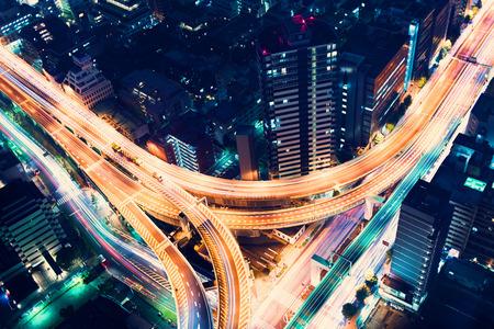 Foto de Aerial view of a massive highway intersection at night in Shinjuku, Tokyo, Japan - Imagen libre de derechos