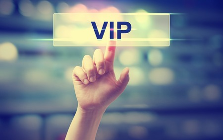 Foto de VIP concept with hand pressing a button on blurred abstract background - Imagen libre de derechos