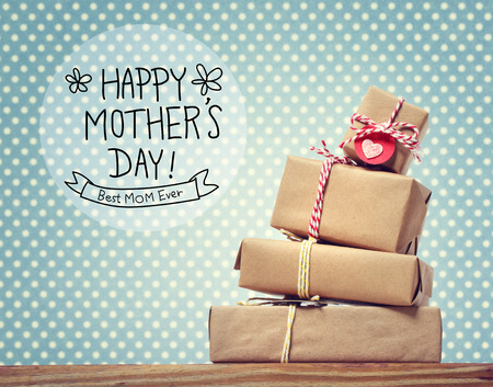 Photo for Mothers Day message with stack of gift boxes - Royalty Free Image