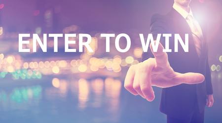 Photo pour Enter To Win concept with businessman on blurred city background - image libre de droit