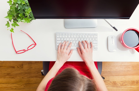 Foto per Woman working in her home office from high angle - Immagine Royalty Free