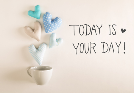 Photo for Today Is Your Day message with blue heart cushions coming out of a coffee cup - Royalty Free Image