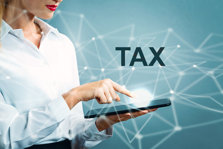 Tax text with business woman using a tablet