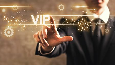 VIP text with businessman on dark vintage background