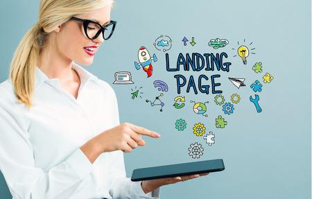 Photo pour Landing Page text with business woman using a tablet - image libre de droit
