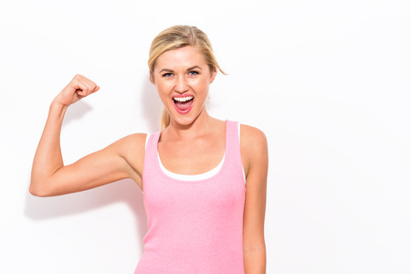 Foto de Powerful young fit woman on a white background - Imagen libre de derechos