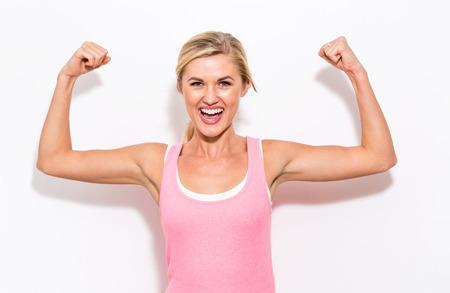 Foto de Powerful young fit woman on a white background - Imagen libre de derechos