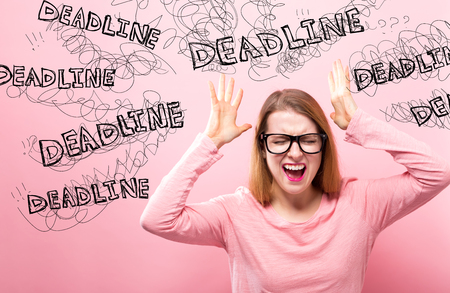Deadline with young woman feeling stressed on a pink background
