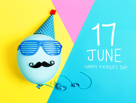 Fathers day message with party balloon with hat and glasses