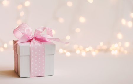 Photo for A gift box on a shiny light background - Royalty Free Image