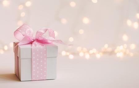 Foto de A gift box on a shiny light background - Imagen libre de derechos