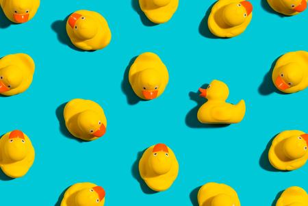 Photo pour One out unique rubber duck concept on a blue background - image libre de droit