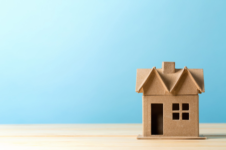 Photo for Mini residential craft house on a blue background - Royalty Free Image