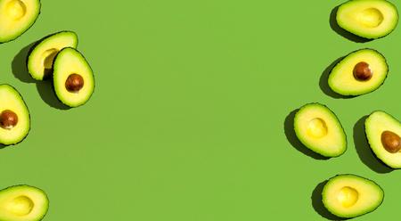 Photo pour Fresh avocado pattern on a green background flat lay - image libre de droit