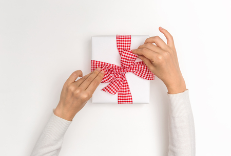 Photo for Making a Christmas gift box on a white background - Royalty Free Image
