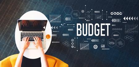 Photo pour Budget with person using a laptop on a white table - image libre de droit