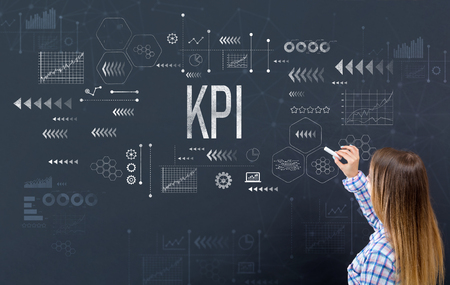 Photo pour KPI with young woman writing on a blackboard - image libre de droit