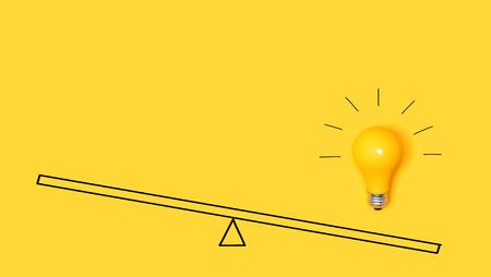 Foto de Idea light bulb on a scale on a yellow background - Imagen libre de derechos