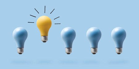 Foto de One outstanding idea concept with light bulbs on a blue background - Imagen libre de derechos