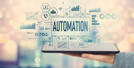 Photo pour Automation with man holding a tablet computer - image libre de droit