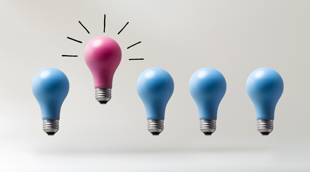 Photo for One outstanding idea concept with light bulbs on a gray background - Royalty Free Image
