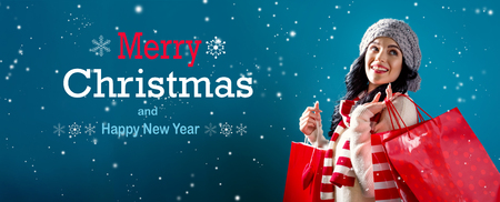 Merry Christmas and Happy New Year message with young woman holding shopping bags