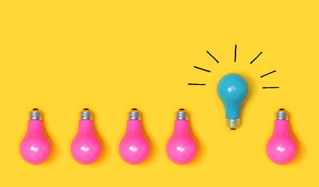 Photo for One outstanding idea concept with light bulbs on a yellow background - Royalty Free Image
