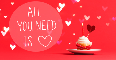 Photo for All You Need Is Love message with cupcake and heart ornament - Royalty Free Image