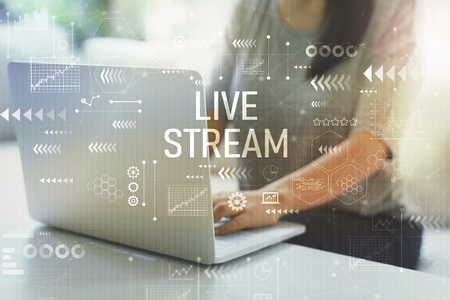 Photo pour Live stream with woman using her laptop in her home office - image libre de droit