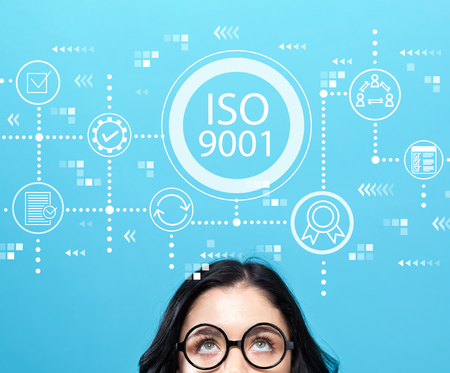 Photo for ISO 9001 with young woman wearing eye glasses - Royalty Free Image