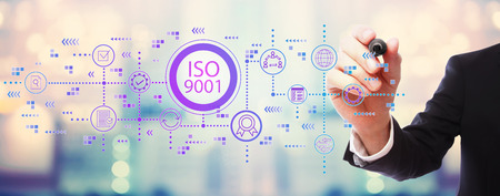 Photo pour ISO 9001 with businessman on blurred abstract background - image libre de droit
