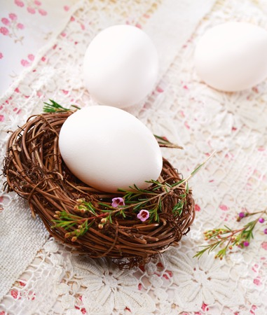 Photo for Easter theme with eggs and little nest - Royalty Free Image